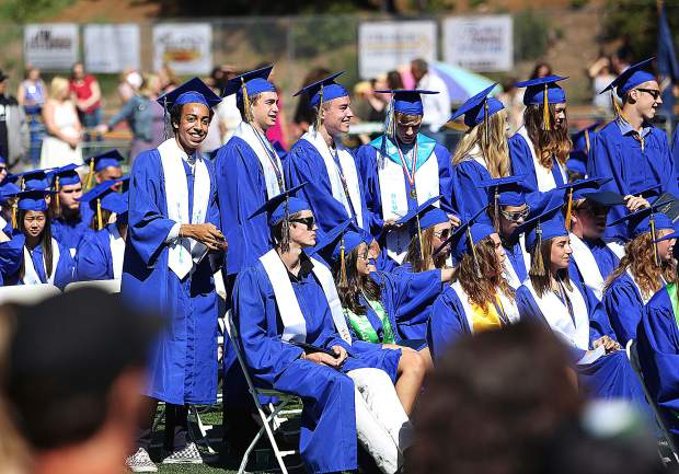Graduates look to acknowledge their friends and family in the crowd during Saturday morning's Nevada Union High School graduation ceremony.