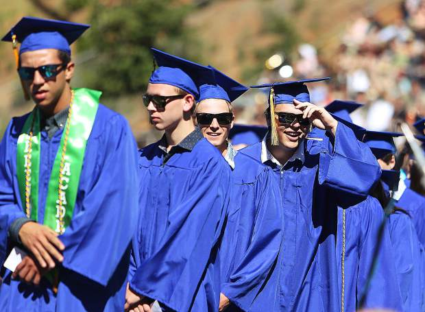 A group of cool looking graduates make their way up on the stage to receive their diplomas during Saturday's Nevada Union High School graduation ceremony.