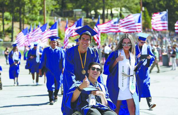 A group of Nevada Union High School graduates make their way back to the Ali Gymnasium to pick up their diplomas after walking through Saturday morning's graduation of the class of 2019.