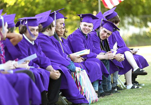 Silver Springs Graduates recognize one another while receiving their diplomas during Thursday evening's graduation ceremony.