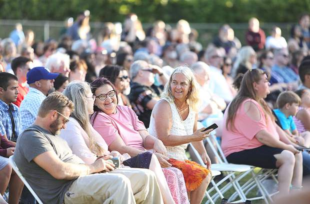 Members of the crowd are ready to cheer on their Silver Springs High School graduates during Thursday evening's ceremony at the school's grounds.