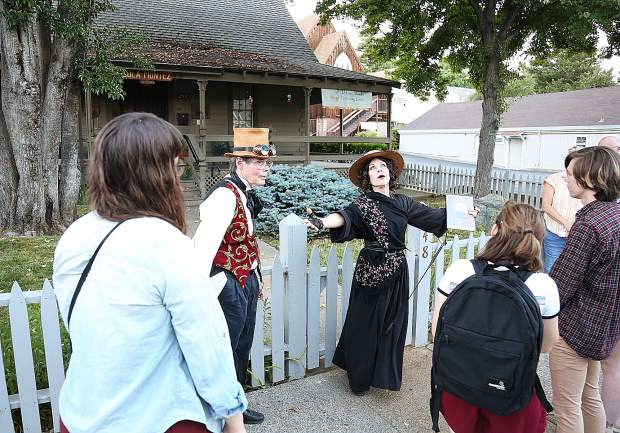 Lola Montez stands in front of a replica of the home that the historical figure once lived and worked out of during Saturday's historical tour led by Professor Personius Delusio, aka Mark Lyon.