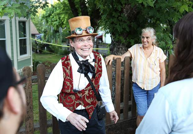 Professor Personius Delusio, aka Mark Lyon, smiles as he leads a group of curious community members on a tour back in time through the history of downtown Grass Valley during a handful of tours held over the weekend.