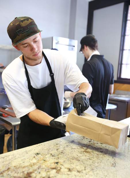 Grass Valley Pasty Co. co-owner Tyler Rickards works behind the counter filling orders for hungry pasty seekers.