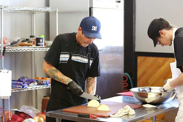 Grass Valley Pasty Co. co-owner Jesse Hopper works on the ingredients that will go into their Cornish Pasty's from their shop now open for take out orders on the corner of Main and South Auburn Streets.
