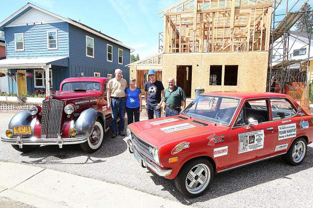 Great Racers from Grass Valley include Bill and Carolyn Croker, next to their 1936 Packard called Molly Maroon, and Robert Brocke, next to his 1972 Datsun. Standing between the racers is Habitat for Humanity's fund developer Jim Phelps, whose organization is set to receive funds raised from the race.