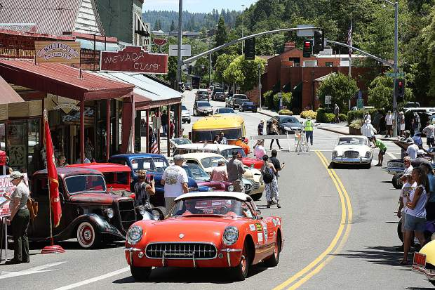 A classic Corvette is followed by a Studebaker during Monday afternoon's Great Race events in Grass Valley.