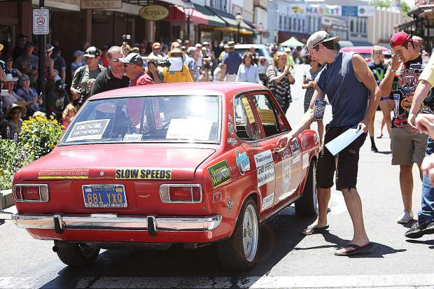 Student navigators Seth DeSena and Damien Christin re-enter Robert Brocke's 1972 Datsun 1200 after rolling into downtown Grass Valley for The Great Race 2019.