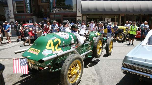 Folks gather to see the vintage road racers arrive in downtown Grass Valley.