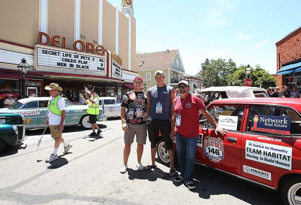 Student navigators Seth DeSena and Damien Christin re-stand with Robert Brocke and their 1972 Datsun 1200 they are using to participate in the Great Race 2019.