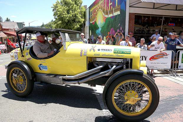 A 1916 Hudson Racer rolls through the intersection of Mill and Main Street in downtown Grass Valley to much fanfare from the community during Monday's lunch stop for the Great Race 2019. Over 150 vintage vehicles took part in the road rally for a good cause between Riverside and Tacoma, Washington.