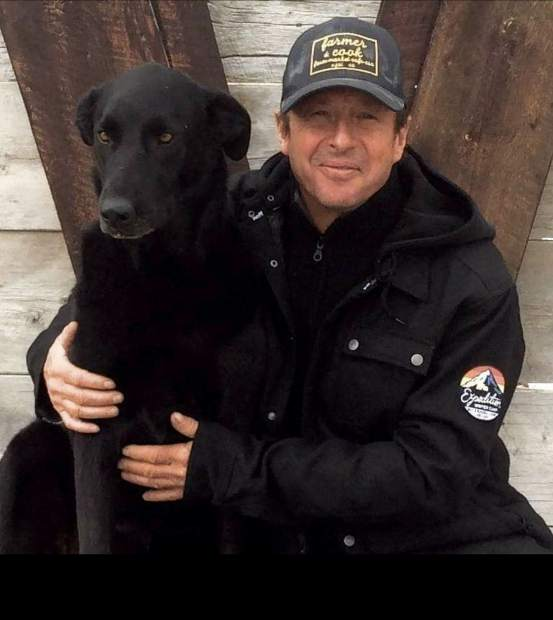 Mark Brooks and his dog, Polly.