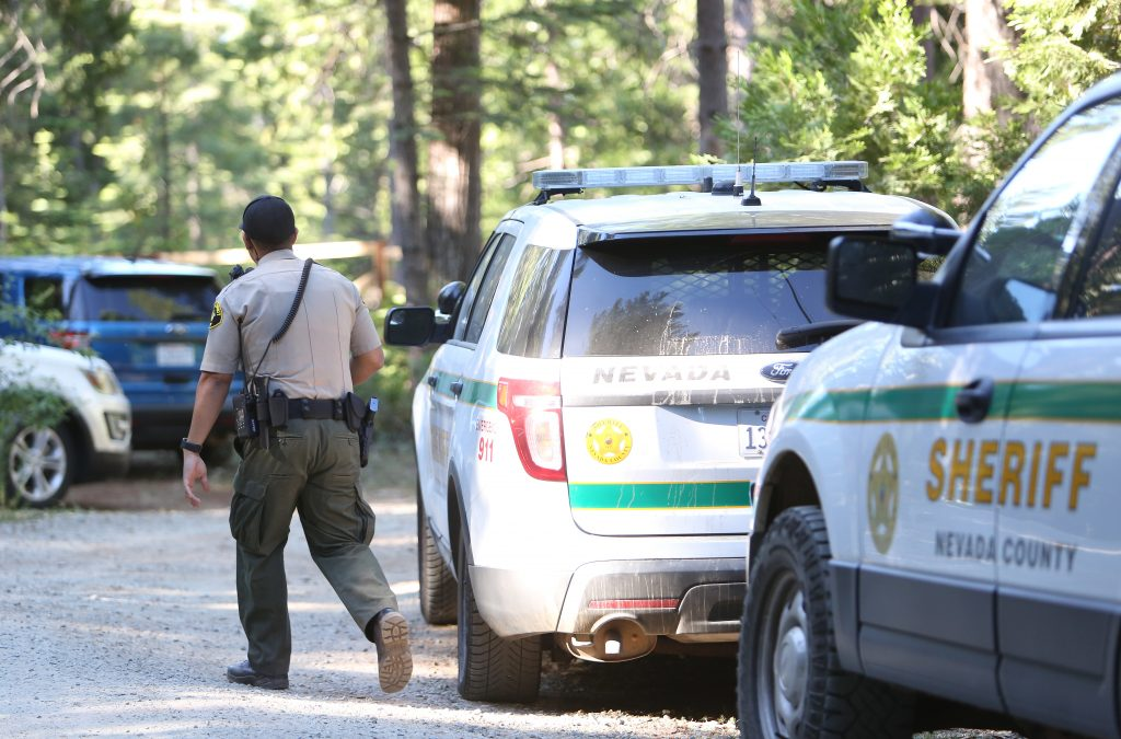 Nevada County Sheriff's deputies work the scene of the 10,000 block of Laurentian Way east of Nevada City where a shipping container exploded in a honey oil hash operation.
