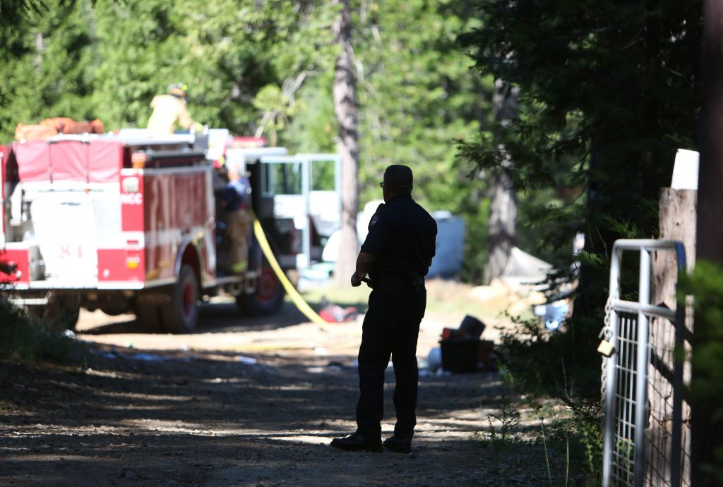 Firefighters mop up the scene of a honey oil lab explosion off of Laurentian Way east of Nevada City Wednesday morning.