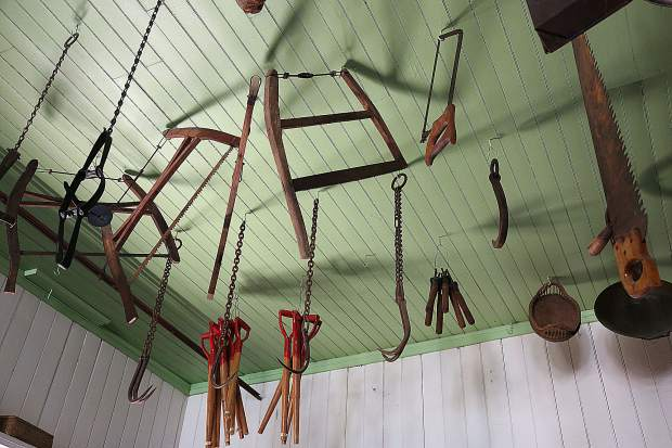 Hay hooks and saw blades hang from the ceiling of the restored McKilligan and Mobley General Merchandise Store resembling a scene from a horror story.