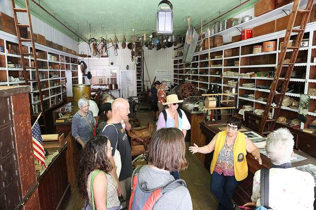 Malakoff Diggins State Historic Park docents help to show off the interior of the McKilligan & Mobley General Merchandise Store during Saturday's Humbug Day celebration on the streets of North Bloomfield, formerly Humbug. Attendees of the 53rd annual event once called Homecoming, allowed attendees to hear stories of the hydraulic gold mining days and even got to see one of the old water monitors in action. The day also included a parade, music, gold panning, candle making and other events that helped to bring life back to the streets of North Bloomfield.