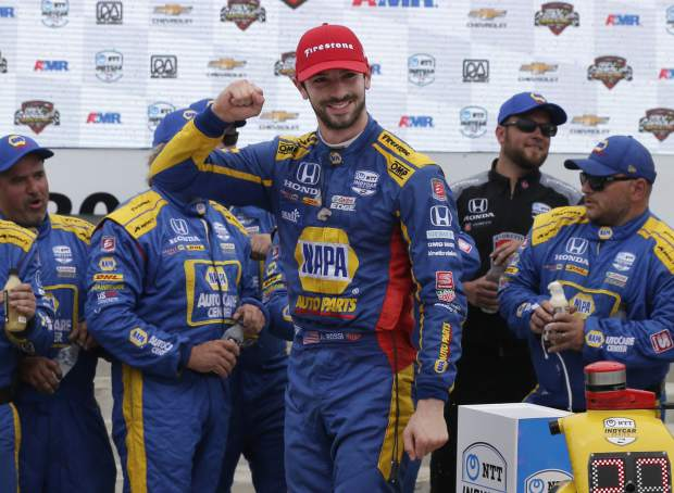 Alexander Rossi celebrates his win at the Rev Group Grand Prix, Sunday, June 23, 2019, at Road America in Elkhart Lake, Wis.