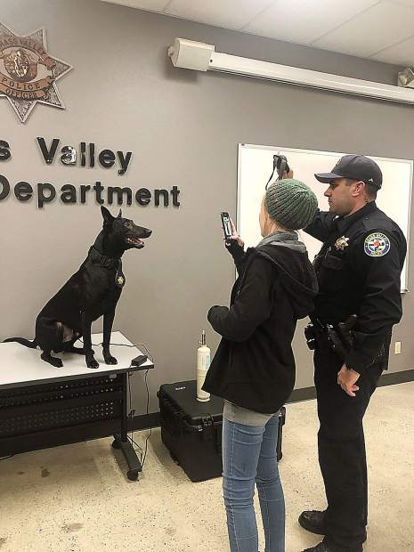 Grass Valley Police Department Officer Evan Butler and Kaydence Smith staged a photo shoot in February, giving Kaydence plenty of photographs to refer to while she drew a portrait of K9 officer Kano.
