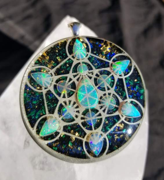 Branch Ellison's Metatron Cube orgonite pendant with 13 Ethiopian opals is one of many  designs that will be included in the upcoming art exhibit during July at Elixart in Nevada City.