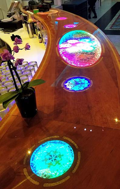 The orgonite bar at Elixart in San Francisco is a good example of collaborative art between Branch Ellison's jewel-crafting and Travis Pope's wood-working skill.