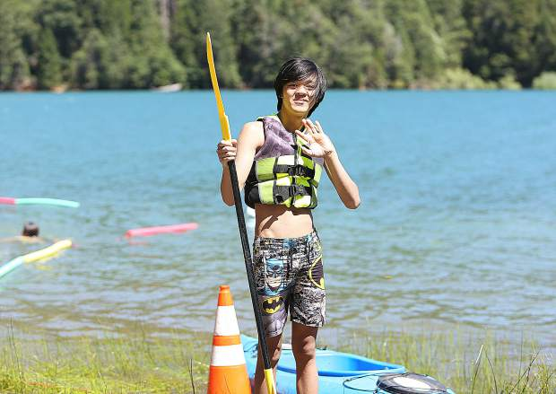 Thadeus Henderson holds an oar as he readies to head out on a kayak Wednesday afternoon during the extended school year program offered by the Nevada County Superintendent of Schools.