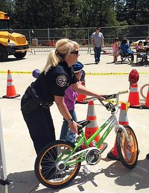Grass Valley Police Department officer Sara Perry is involved in many youth organizations, and often provides life-saving Driving-Under-the-Influence education.
