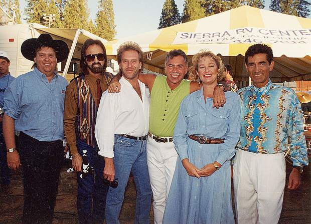 George Rath, left, Lorraine Jewett, second to right, introduced the Oak Ridge Boys one night for the group's performance at the Nevada County Fairgrounds.