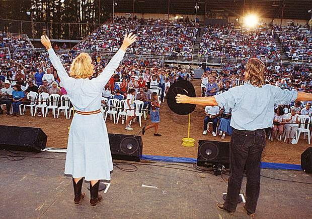 Lorraine Jewett and George Rath introduced the acts that came rolling through the fairgrounds. One night, the duo egged on the audience to stand up and cheer for the headliners for the sole purpose of getting this picture. The show started a bit later ...