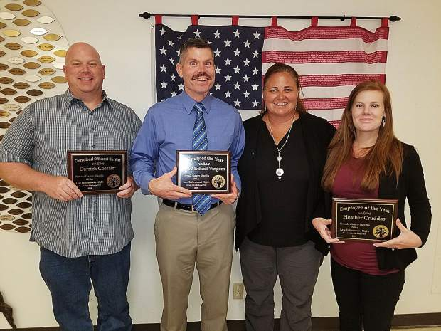 The Nevada City Elks Lodge treated current and retired law enforcement officers to a barbecue dinner, at which various agencies presented awards to employees. Nevada County Sheriff Shannan Moon (center) presented awards to (left to right) Darrick Cossairt, Michael Vingom, and Heather Cruddas.