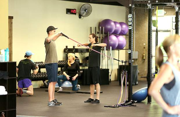 Trainers work with individuals at Best Life Fitness off of Crown Point Circle in Grass Valley.