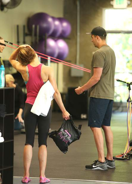 Folks work out with the help of trainers Thursday at Best Life Fitness in Grass Valley.
