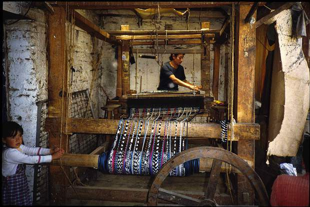 A Guatemalen weaver makes fabric for Nzuri Textiles, based in Nevada City.