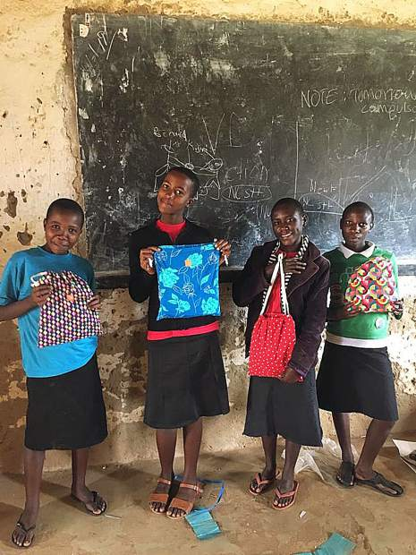 "Ugandan school girls proudly display their newly acquired ""Days for Girls"" kits."