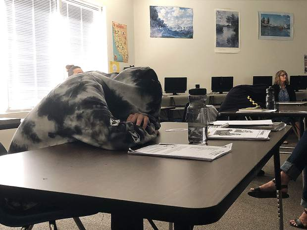 This Earle Jamieson student isn't sleeping. He's practicing mindfulness just as he does at the beginning of every school day.