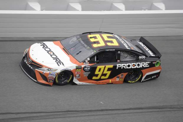File - In this Feb. 10, 2019, file photo, Matt DiBenedetto (95) makes his way through Turn 4 during qualifying for the NASCAR Daytona 500 auto race at Daytona International Speedway in Daytona Beach, Fla. DiBenedetto drove his Leavine Family Racing Toyota at the Sprint Cup Series auto race in Sonoma, Calif., Sunday to his first top-five finish in the 156th career start of a career spent with underfunded, back-of-the-pack teams.