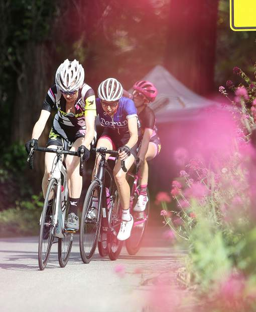 The lead group of Women's Pro racers round a corner of the Nevada City Classic during Sunday afternoon's race.