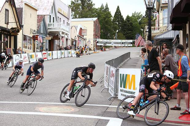 The group of Men's Pro racers make their way down Broad Street and onto Pine Street during a lap of the Nevada City Classic Sunday evening.