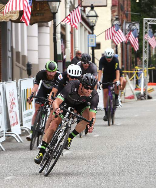 A group of Men's Pro racers make their way down Broad Street and onto Pine Street during a lap of the Nevada City Classic Sunday evening.