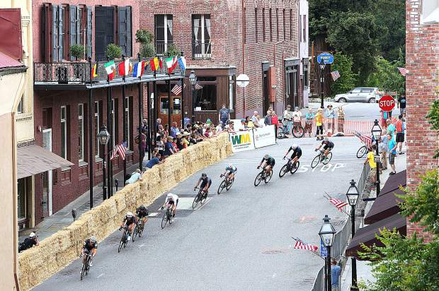 Nevada City Classic Men's Pro Racers make their way around one of the final turns of the Nevada City Classic 1 mile bicycle race course down Pine Street where a last minute crash scattered riders across the course and paving the way for an unlikely winner.