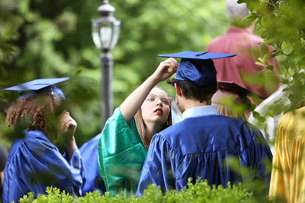 Bitney Prep class of 2019 grads make sure that everyone's ready to go in the rose garden prior to their ceremony at Mount Saint Mary's Academy.