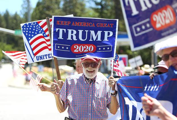 Rural Grass Valley resident Eddie Garcia holds his Keep America Great Trump 2020 sign along side a group of other local Republicans in support of President Trump's re-election during a rallty at the intersection of Brunswick and Sutton Way in Grass Valley.
