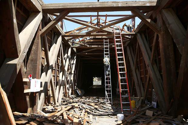 The framework of the historic Bridgeport covered bridge sees light for the first time in decades as the shingles are removed from the structure to prepare for further restoration work and the raising of the 1862 structure.