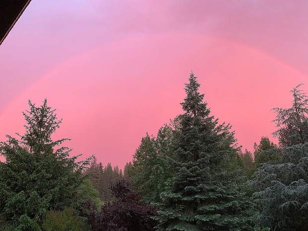 I took these photos Saturday evening during the storm. The setting sun made the sky turn pink and then a rainbow appeared. Storm clouds also caught a bit of the last sunlight.