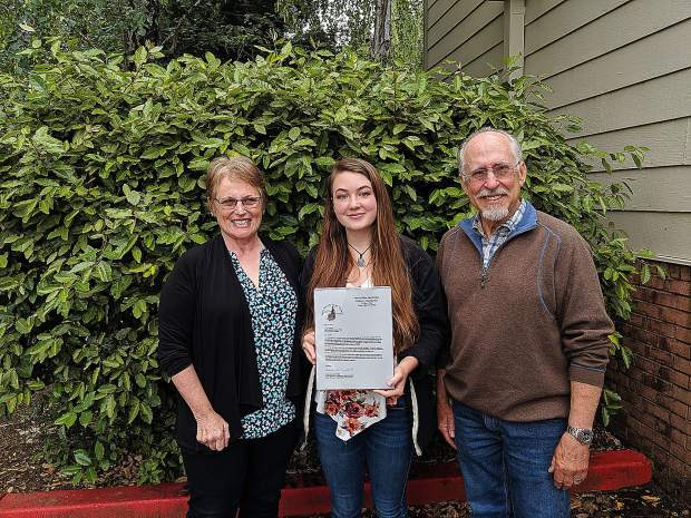 Forest Charter School senior Lacey Mulford was awarded a $2,000 scholarship by the Sierra Wine & Grape Growers Association (SWGGA). Susan Clarabut and David Blitzein, of SWGGA, presented Lacey with this award based on Lacey's goal of a career combining engineering and agriculture with a focus on organic farming. Lacey will begin her studies this fall at Sierra College's Nevada County Campus and plans to transfer to UC Santa Cruz after two years.