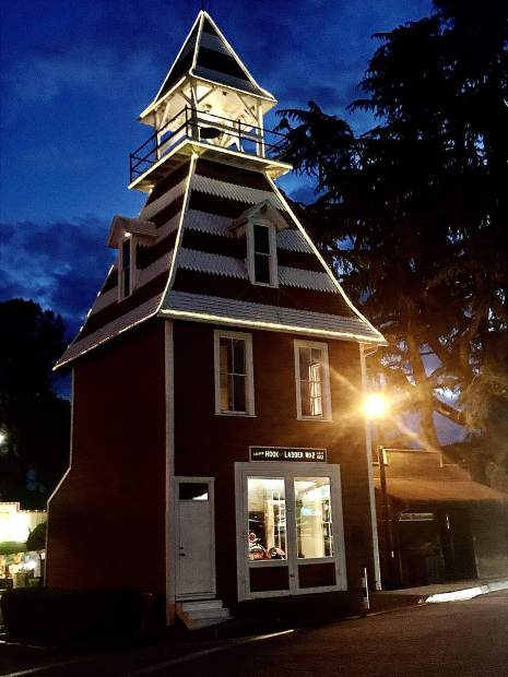 Auburn's Oldtown Hook and Ladder #2 lit up at night.