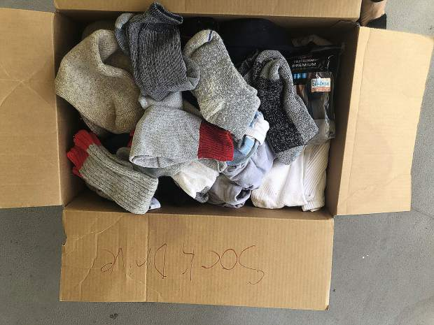 Thomas Gruver, a 6th grade student at Seven Hills Middle School, offered to host a sock drive for Hospitality House earlier this spring. Thomas reached out to us to learn more about homelessness and needs at the shelter, and from there, he led the drive on his own. He rallied his 6th grade peers to give — and they did! On their last day of school this past Friday, Thomas called me to share the good news. They had collected a large box of new and gently used socks. Socks are one of the most-needed items at our shelter and something our guests need year-round. This young man has such a big heart and we are most grateful to him and his classmates for caring so much about our community. Thank you, Thomas!