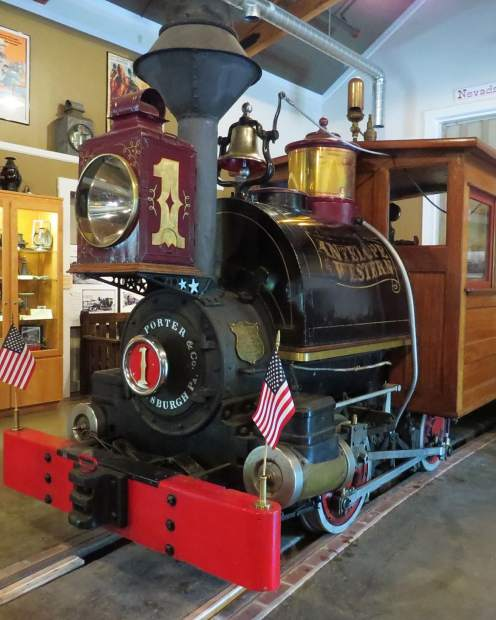 The Nevada Country Narrow Gauge Railroad Museum raiilbus takes riders on a trip through the local woods.