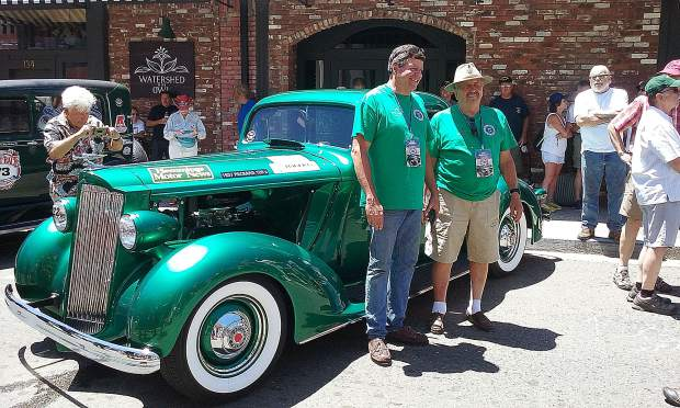 Den Reinhold and Duke Klement pose in front of their 1937 Packard on Mill Street during the lunch stop in Grass Valley for