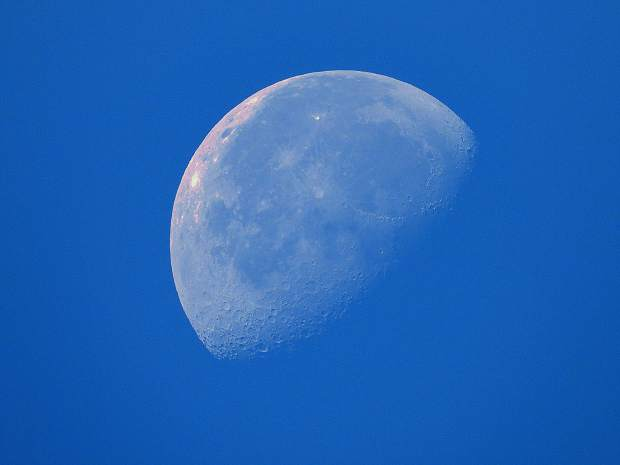 This is a shot of the moon taken early Sunday morning (June 23) against the blue sky. It was interesting to be able to see the craters during daylight.