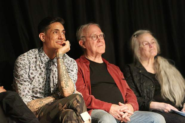 Poetry panelists including David Tomas Martinez (from left), Robert Hass and Sharon Olds watch as their colleagues take their turn sharing their poetry at Friday's Community of Writers poetry scholarship fund event.
